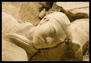 Head of a Terra Cotta Warrior resting on the excavated floor awaiting restoration.